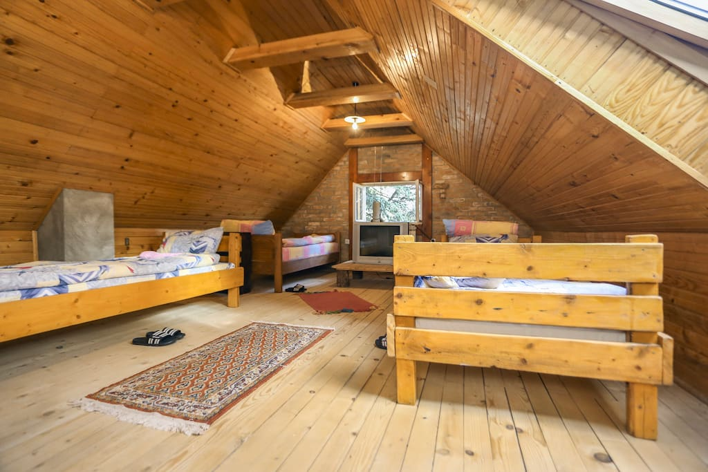 Green room with five beds and shared bathroom