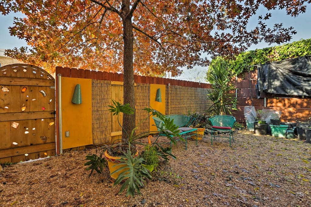 The unique, artistic flair seen on the inside of the home carries through to the backyard.