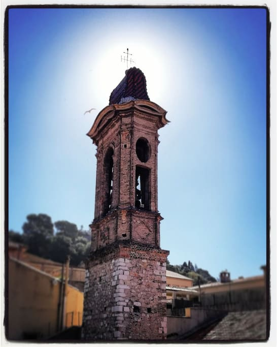Our balcony faces directly the roof and the bell tower of a baroque style church built in 17th century. Behind the bell tower is we have the view of the famous Castle Hill its the waterfall!