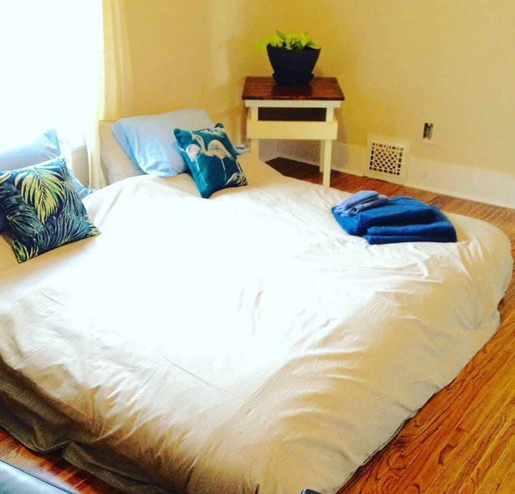 The Oasis room set up with a King sized bed. Can also be set up as two twin beds, or one twin (with the two twin mattresses stacked one on top of the other to elevate it from the floor).