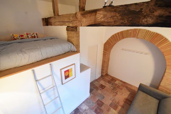 This bedroom sleeps 2 people in the mezzanine bed, and another 2 people in the pull-out sofa bed. There is also an en-suite shower room.
