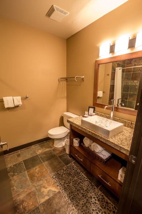 The spa inspired bathroom is spacious and elegant