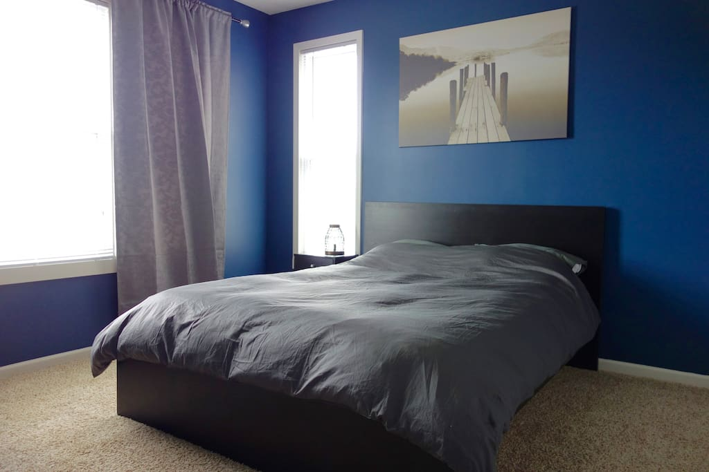 Comfortable queen size bed with views towards the Mississippi River