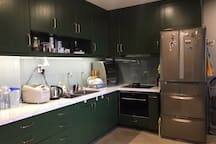Kitchen is fully equipped with all kinds if cooking utensils, a large fridge, oven/microwave and a dishwasher.