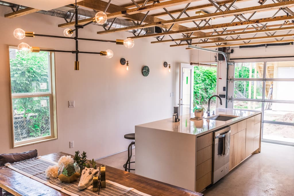 Glass garage door opens up the kitchen to the outdoors