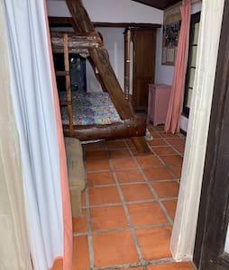 Habitación triple en casa de campo en Chacra