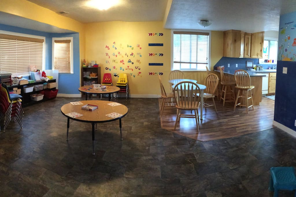 This is the front room.  Preschool size tables and shelves filled with toys.