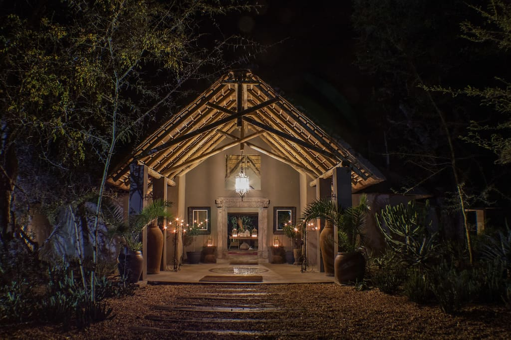 The entrance of The River Lodge at night