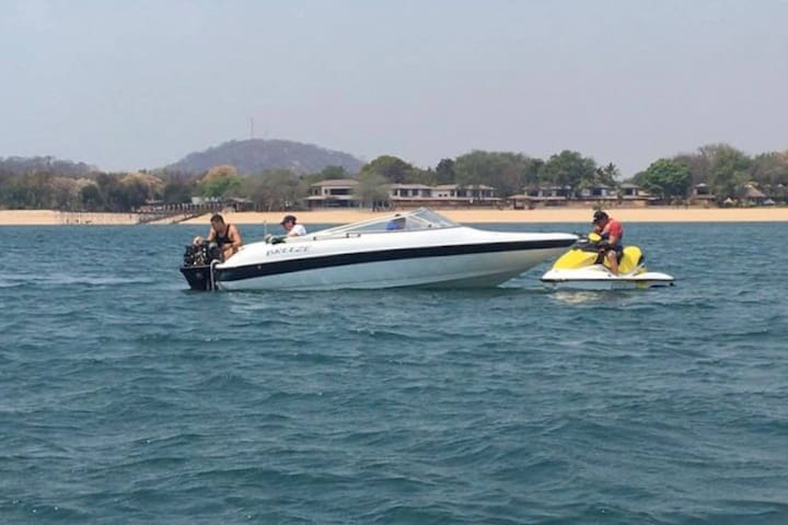 Boat and 3 jet skis