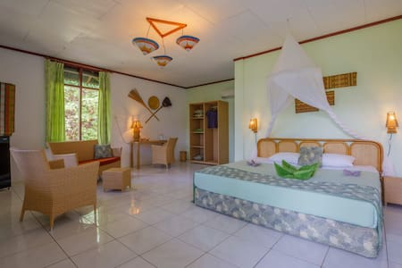 Spacious room in a lush tropical environment.