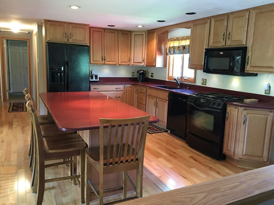 Full Kitchen, Gas cooktop, Microwave, Dishwasher, Corian Counter Tops, Cherry Wood Mode Cabinets