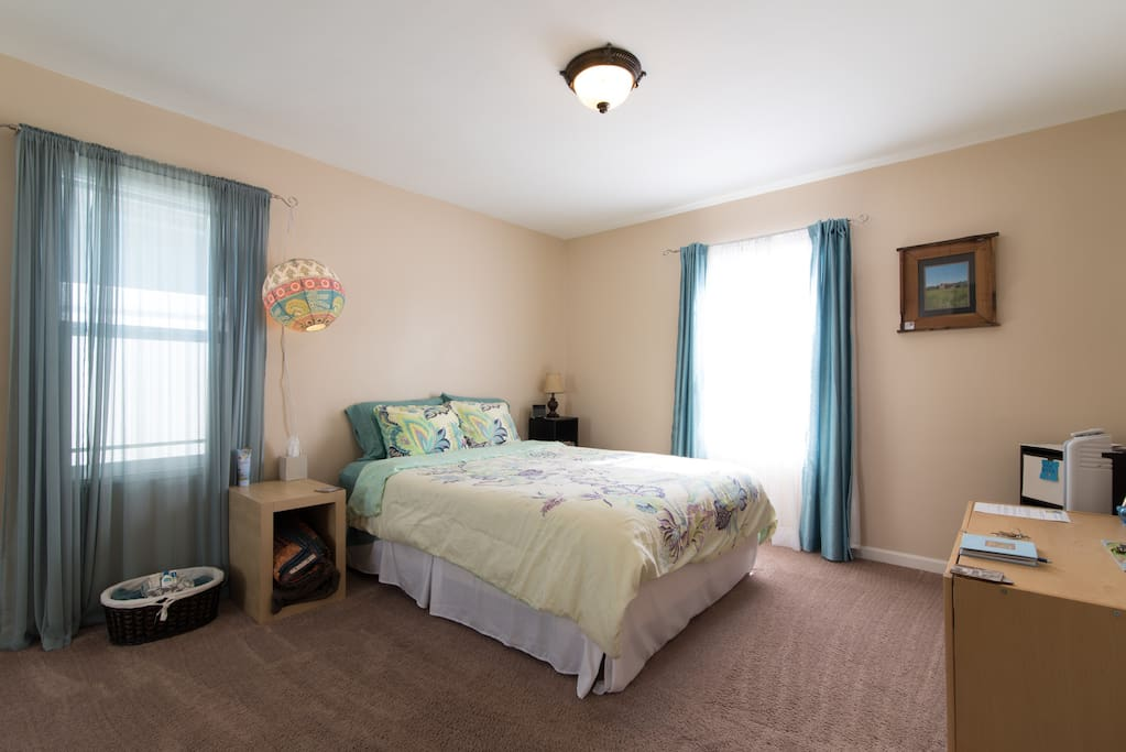 Spacious guest bedroom with queen size bed