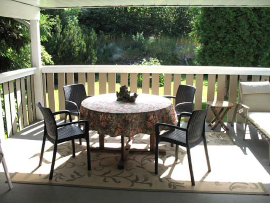 Large private east facing deck.  Nothing compares to enjoying that first cup of coffee while basking in the morning sunshine.  This fully covered deck provides complete shade for  afternoon and evening meals, just relaxing, or when mother nature sends a rare shower our way.