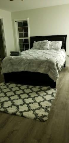 bedroom 1 completed. New wood floors