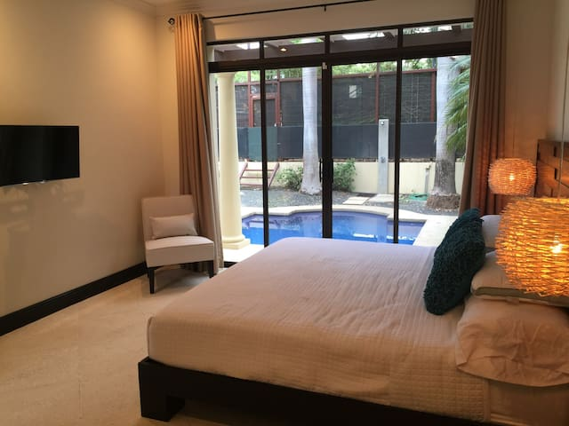 main bedroom with direct access to the pool