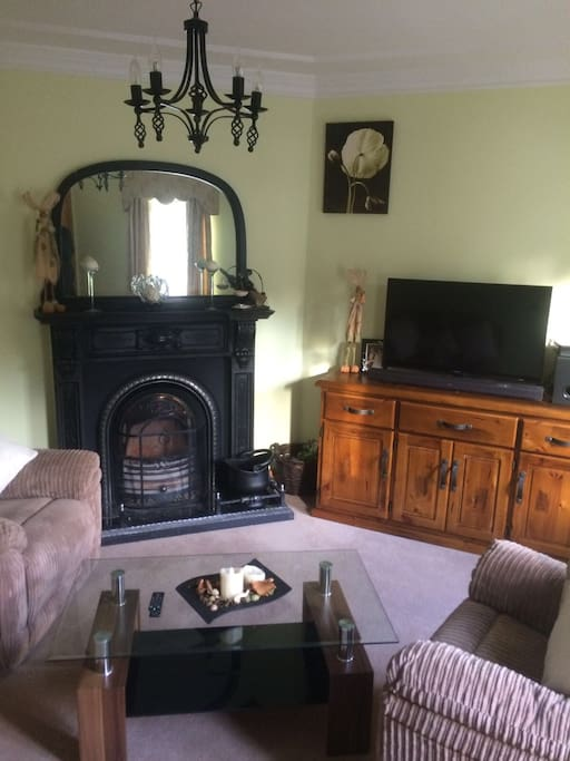 Front living room, open fire and tv