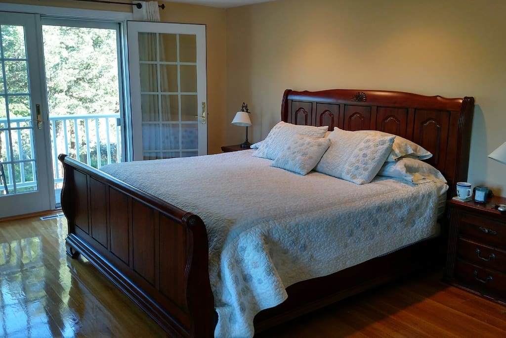 Master bedroom with views of the harbor from deck.