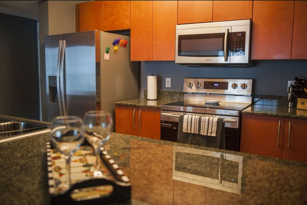 The spacious kitchen serves as the perfect place for preparing succulent, gourmet meals, or a quick snack on your way out to explore.