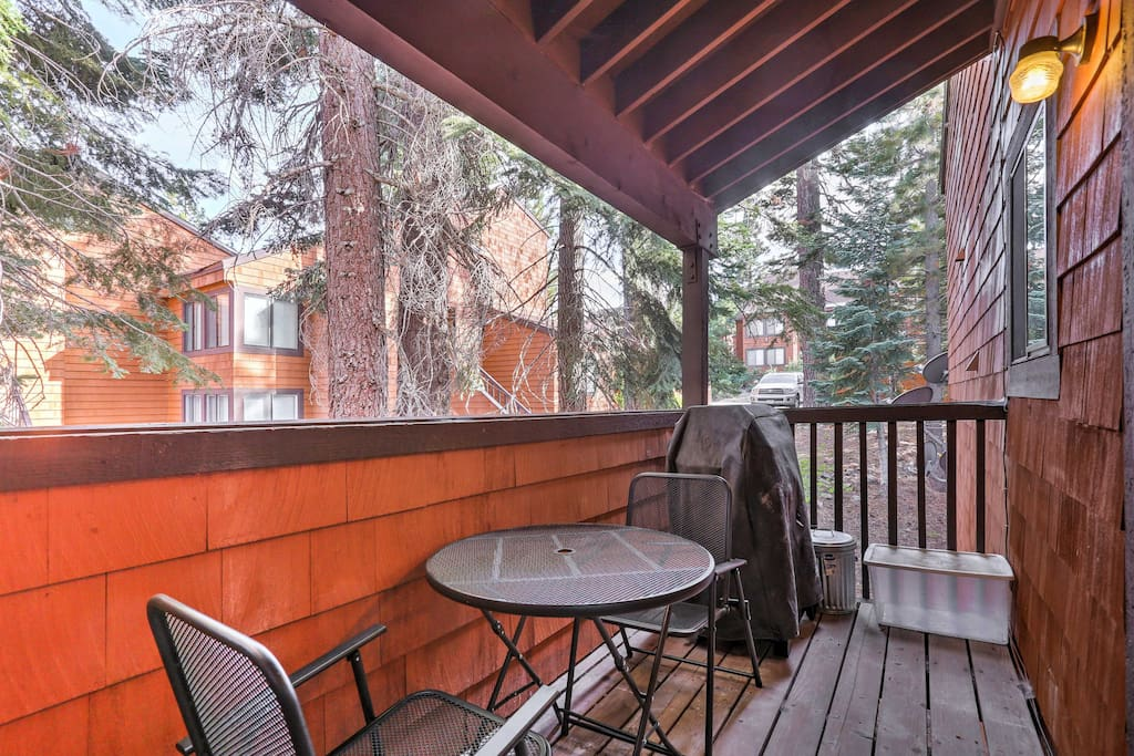 Enjoy your favorite beverage on the private balcony framed by age-old trees.