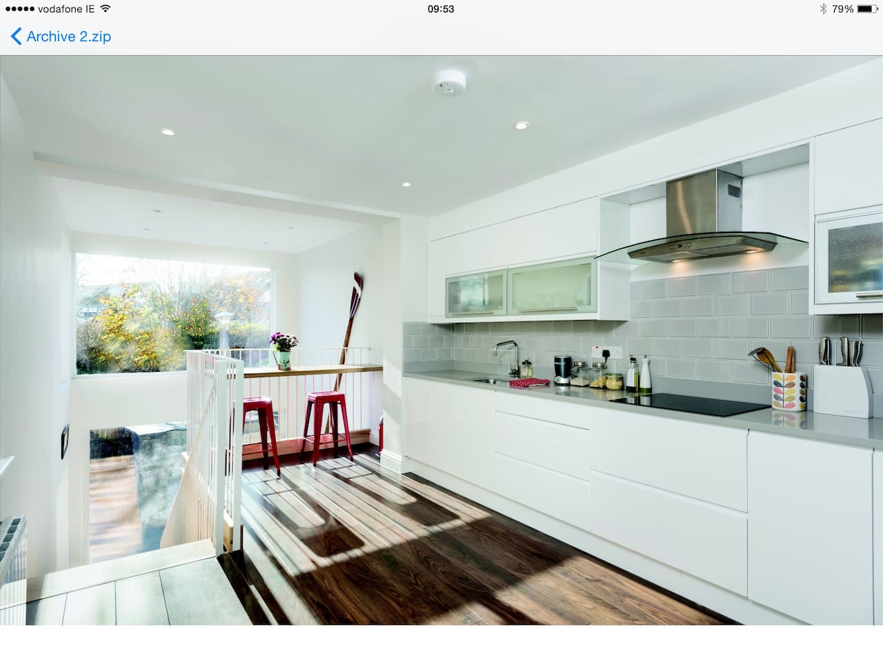 Kitchen with breakfast bar overlooking mezzanine
