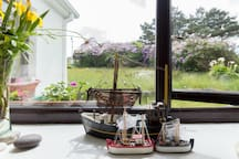 View to the front garden meadow, we're close to the sea, hence the boats
