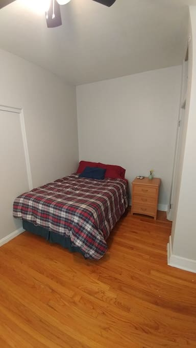 This is the designated bedroom you will be staying if you book this listing. This bedroom is located off the kitchen.