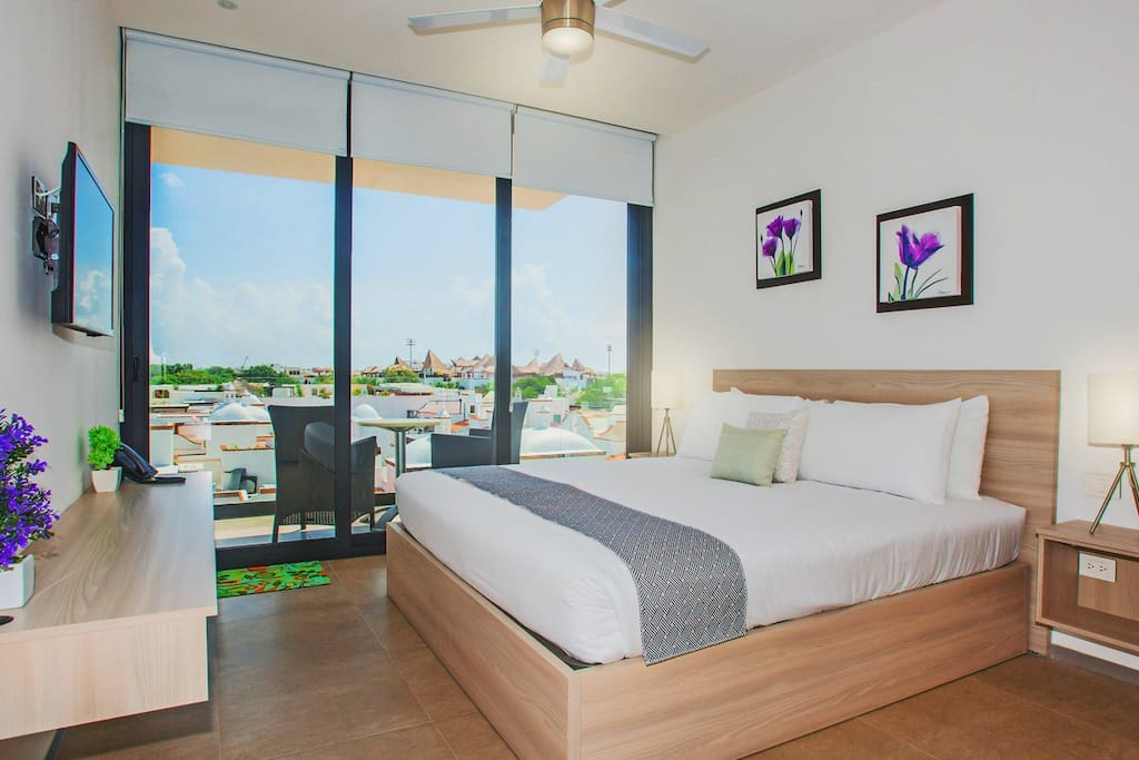 Room with view and king size bed.