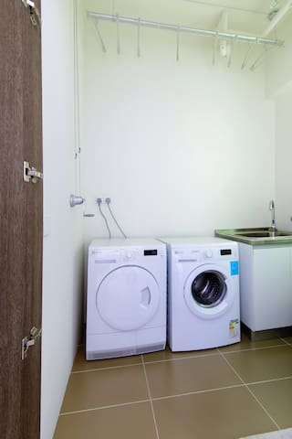 private laundry room with washing machine and dryer