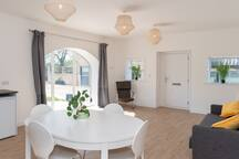 The living space is light, airy and relaxing