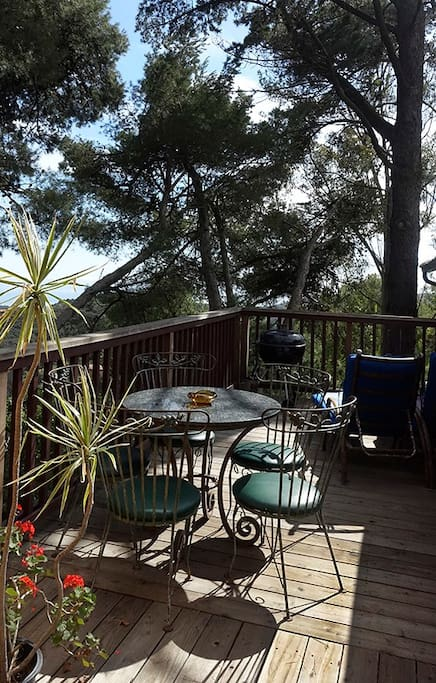 Deck with granite dining table, lounge chairs and BBQ