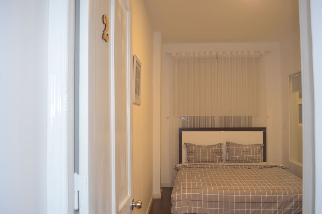 Our brand new room with comfortable bed, clean linens and soft  pillows.