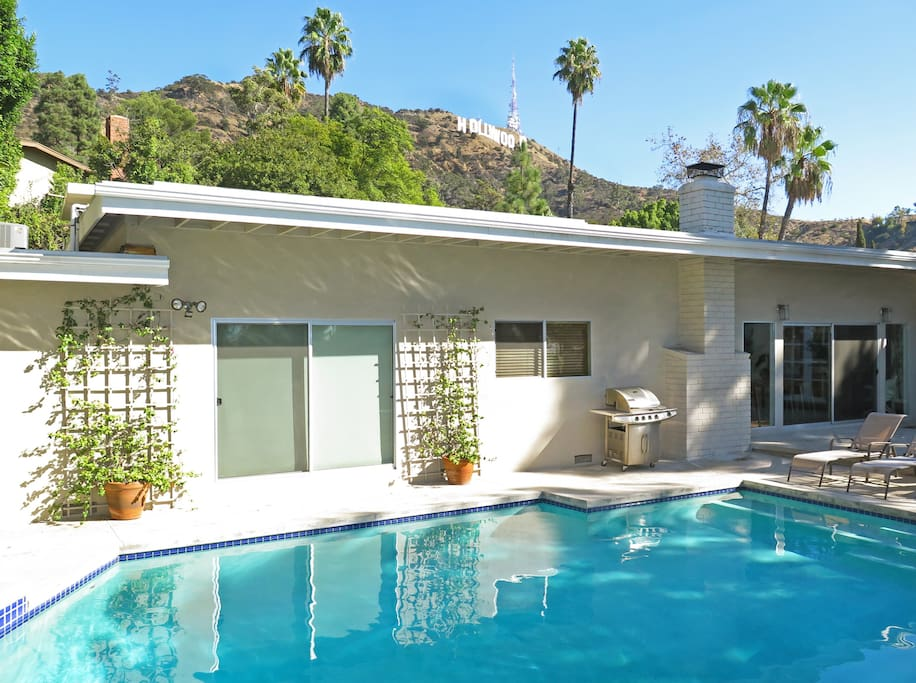 Solar-heated pool/spa overlooking the iconic Hollywood Sign.