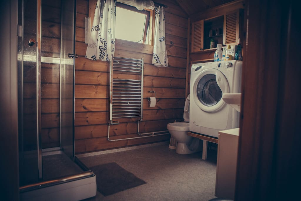 And the wonderful bathroom with a shower and washing machine