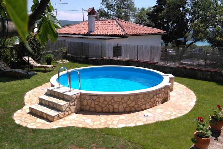 Comfortable family home with pool and garden, covered grill and dining area