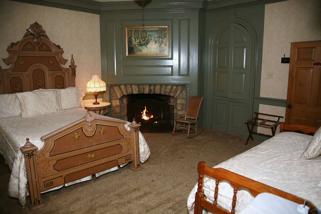Fireplace Room with queen and daybed single.  Private bath. Includes full farmers breakfast.