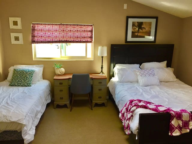 1 of 2 bedrooms offers spacious area 1 twin bed 1 queen bed. The room offers a couch for lounging a desk if needed and a closet for any needed storage.