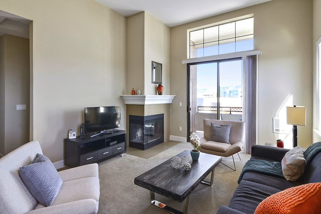 Living room with fireplace, TV attached balcony and sleeper sofa