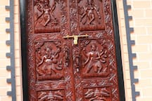 handmade wood carving door with hindu god  and goddess