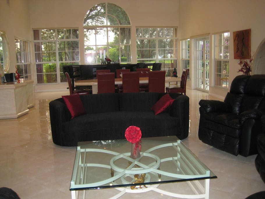 Combination living / dining room with view towards golf course