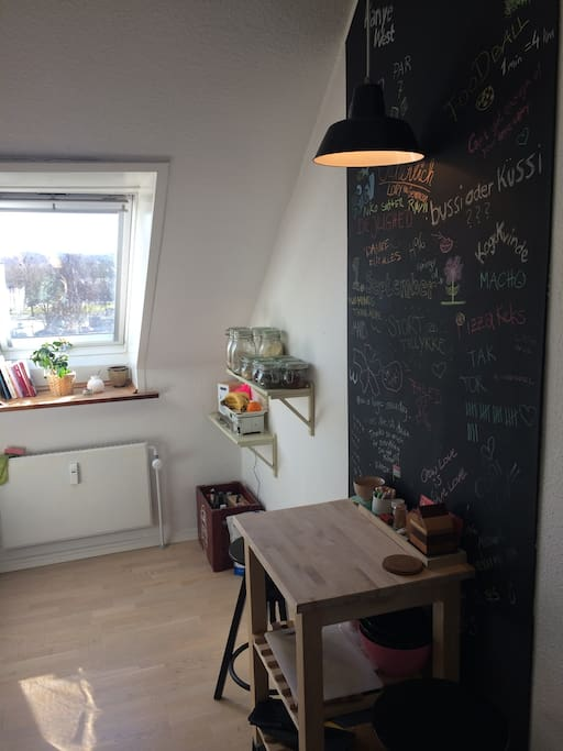 This is the kitchen, which has all the things you will need to make a nice meal. There is also a table where you can have your breakfast or just sit an relax.