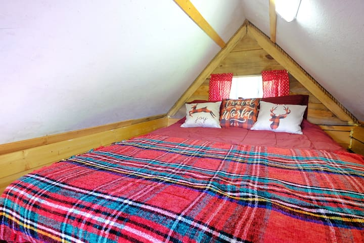 Climb into your cozy loft Queen sized bed