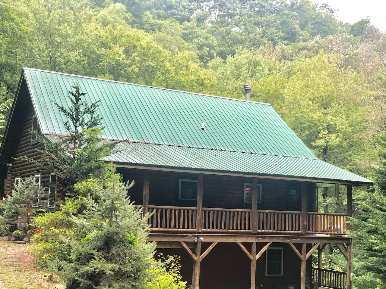 The front of our Maggie Valley Creekside Cabin - its on two acres with Soco Falls Creek running through the backyard. Magical. The perfect getaway!