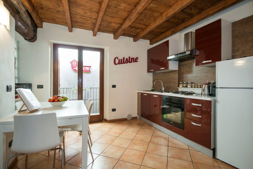 pic by Airbnb - kitchen and dining room (and small balcony)