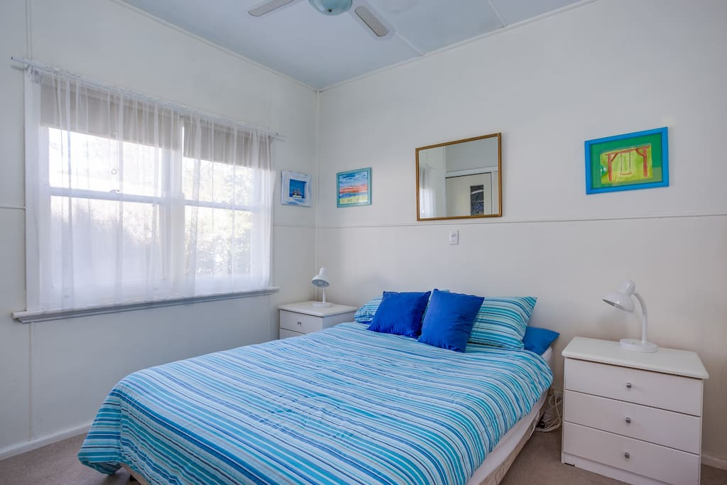 A second room with queen size bed & ceiling fan