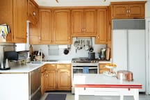 Light filled SHARED KITCHEN leads out to the deck overlooking the garden.  Kitchen is fully equipped.
