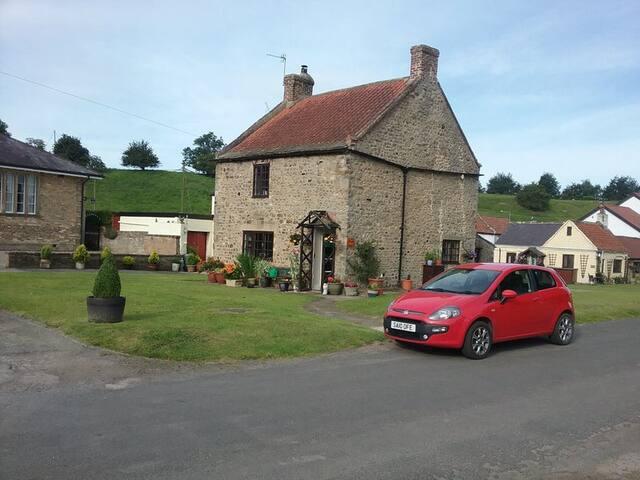 Quiet stone cottage on village green.