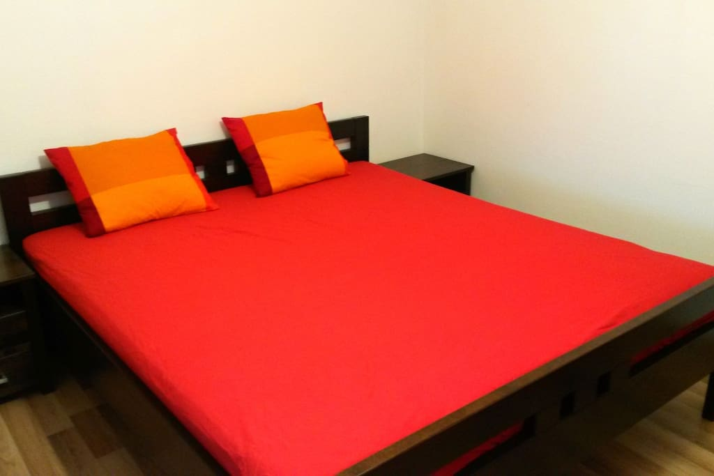 king-sized bed with comfortable mattress