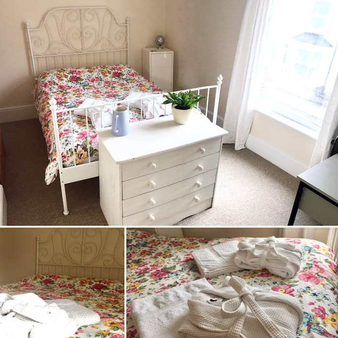 Comfortable double bed with new mattress and cotton sheets.