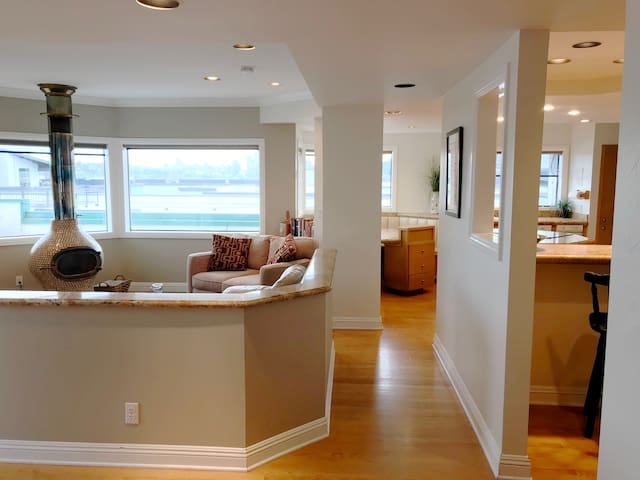 Great view, sunlit living room, deck, wood-burning fireplace and more!