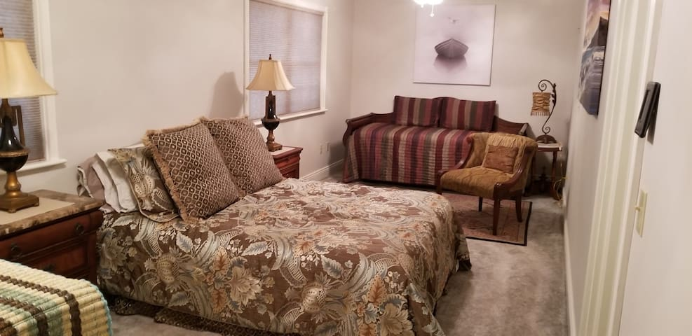 """The """"Harbor Master"""" guest suite offers an Inner coil Queen bed and also a Two XL Twin Trundle to Queen, pop-up bed.  There is plenty of room for your clothes and cargo in our walk-in closet.  A reading chair and, two ceiling fans with ample lighting."""